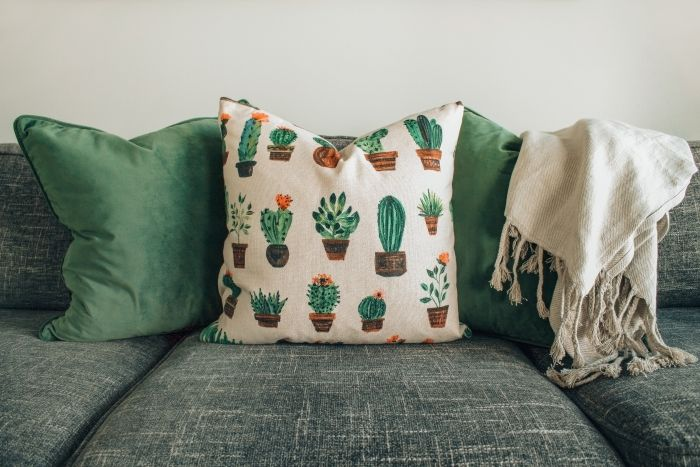 canapea verde din material textil